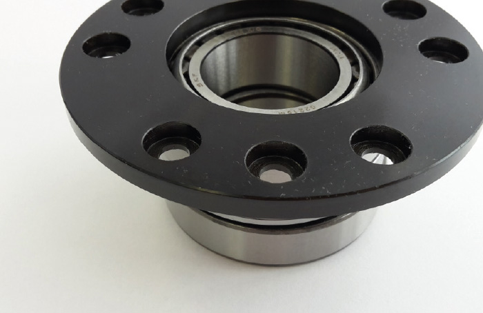 Paired tapered roller bearings with mounting flange